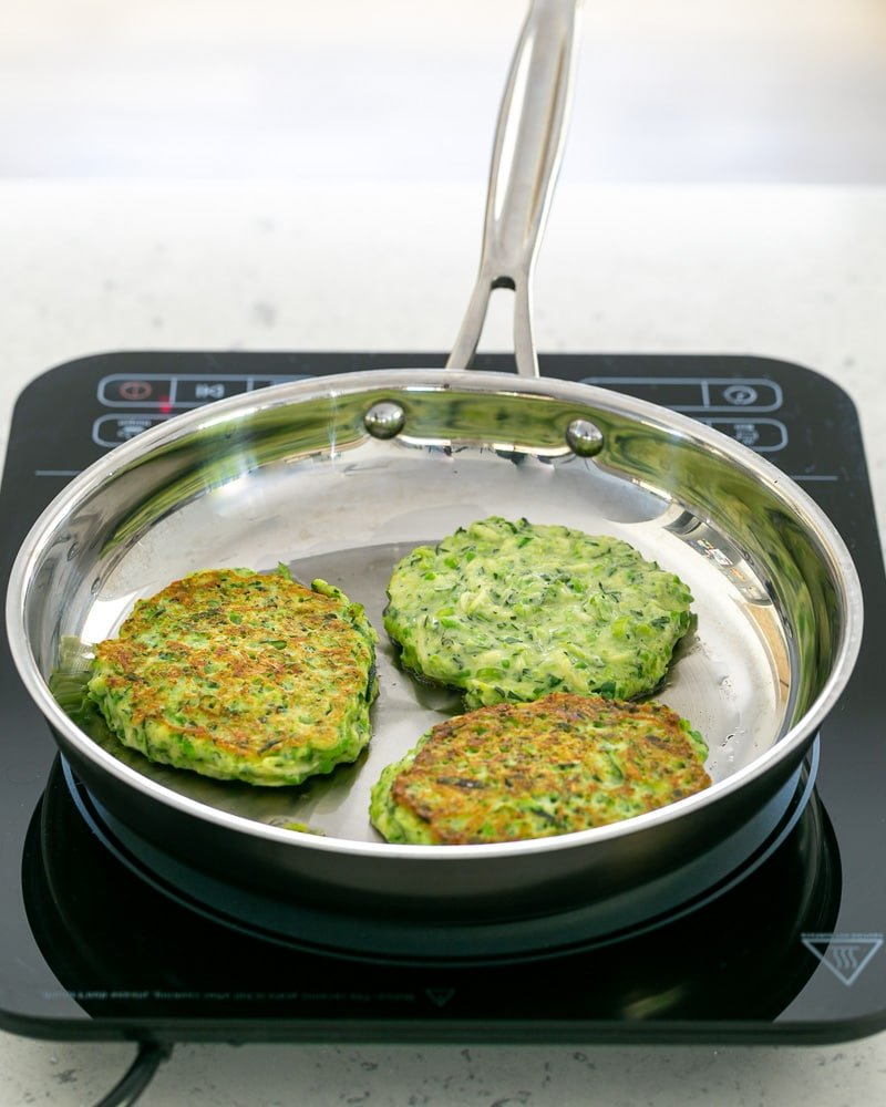 zucchini Fritters in the pan cooking