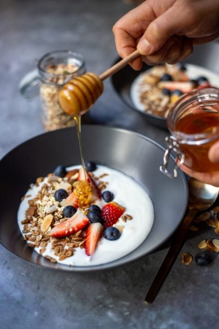 Yoghurt made at home with muesli, berries and honey