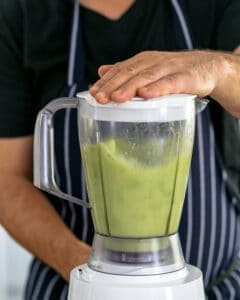 Apple lime juice avocado coconut cream and olive oil blended in a mix to a smooth consistency
