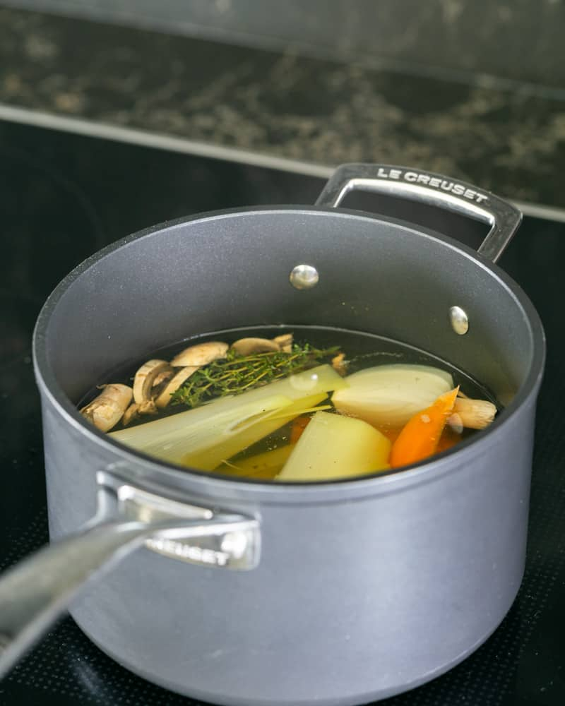 Vegetable stock for the porcini mushroom risotto