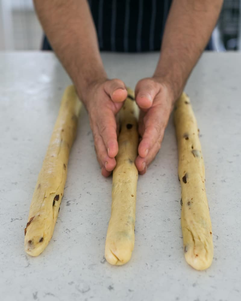 dough being rolled into strands