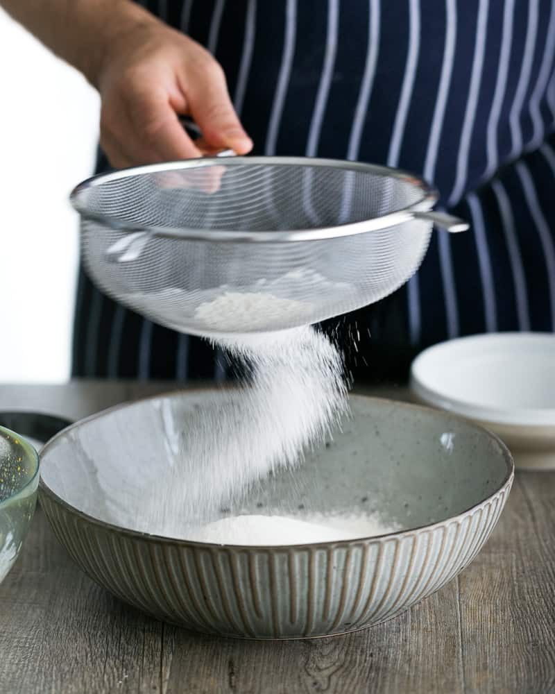 Sifting Flour in a sieve