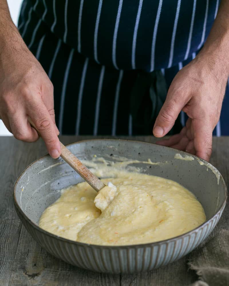 Whipped Egg Whites folded into Pancake Batter for Souffle-style pancakes with fresh ricotta and almonds