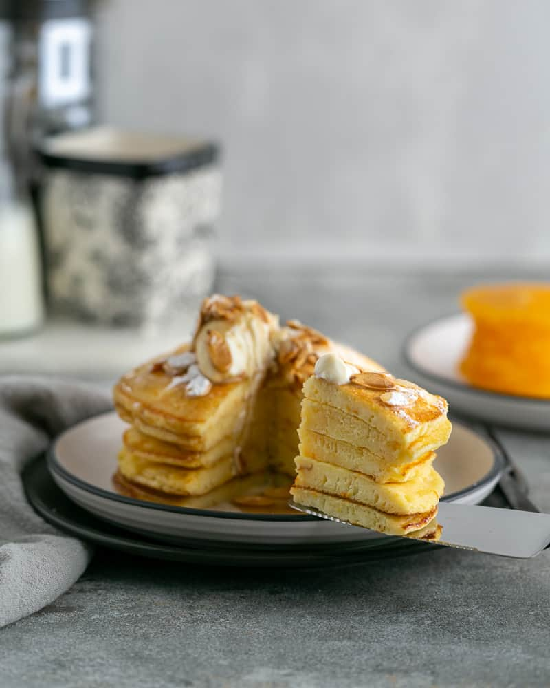 Souffle-Styled Pancake stack Sliced and served with fresh ricotta and almonds