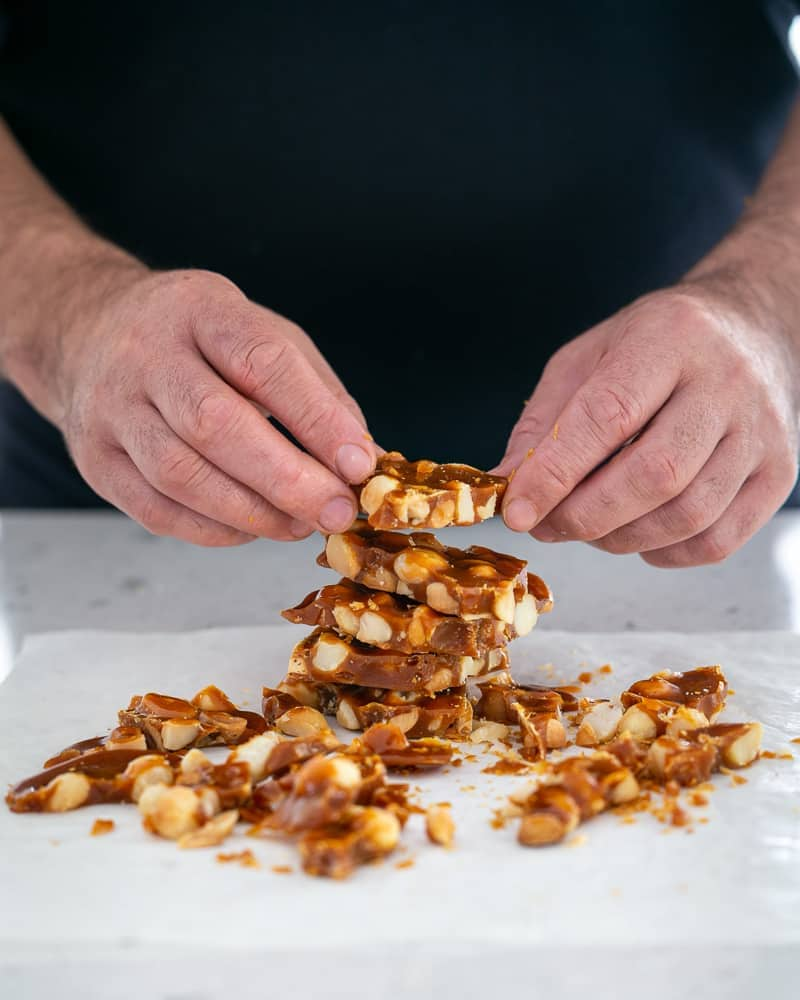 Stack of cut pieces of macadamia nut brittle