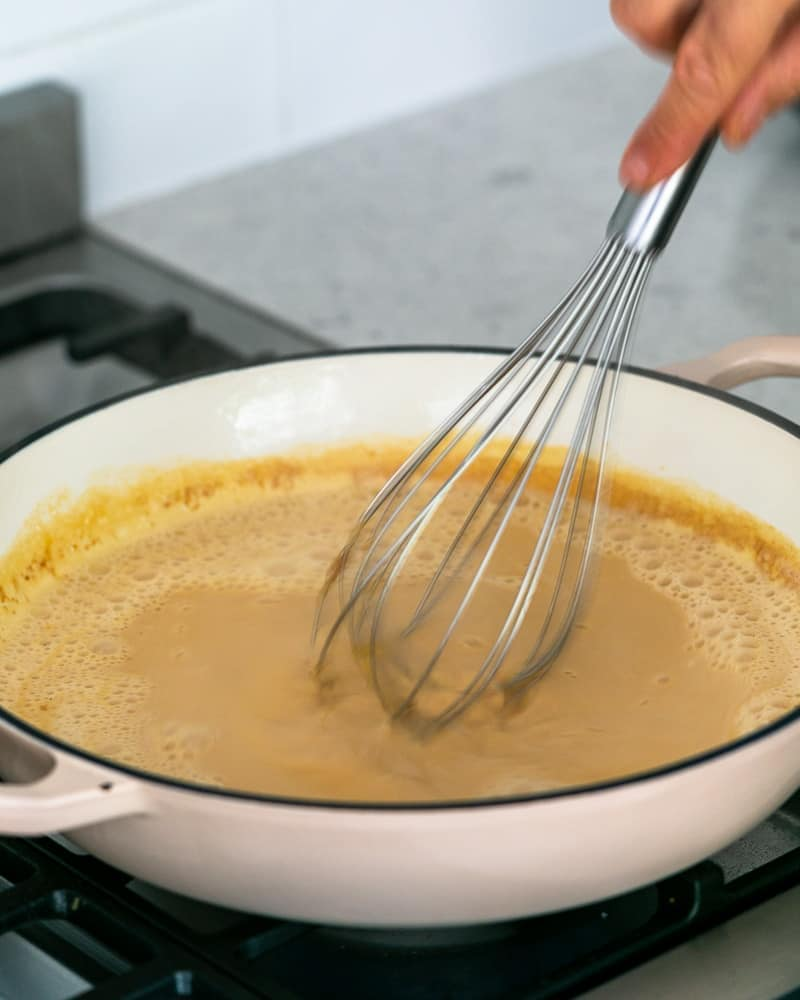 Continuously whisk the caramel and milk and cream mixture to avoid lumps
