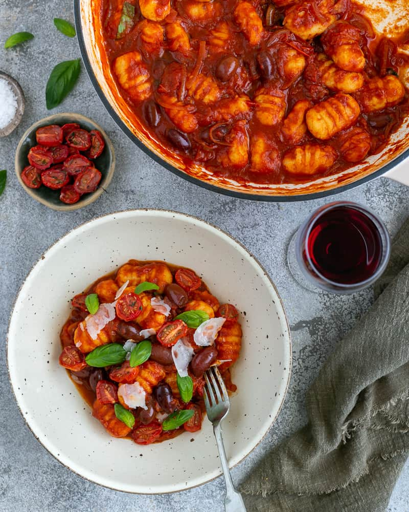 Plating and garnish idea for Easy Ricotta Gnocchi's with tomatoes and olives