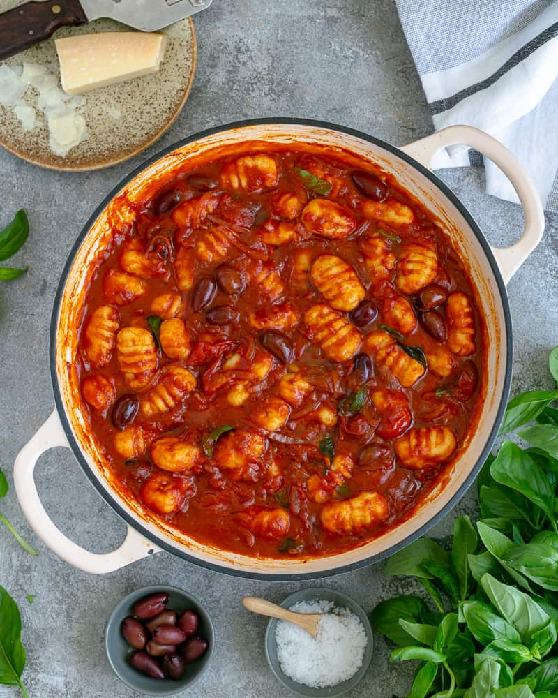 Easy Ricotta Gnocchi with tomatoes and olives in a pan