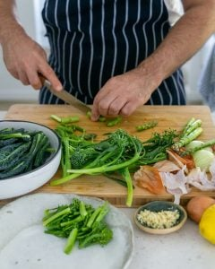 Cutting asparagus stem lengthwise for Casarecce Pasta with Asparagus, Kale and Garlic