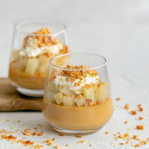 caramel pots with poached pears, whipped cream and macadamia crumble