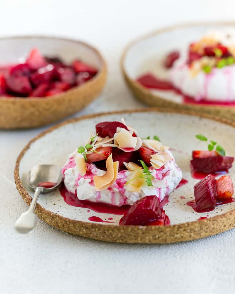 Poached Rhubarb with Strawberries with Coconut Chantilly dessert close up