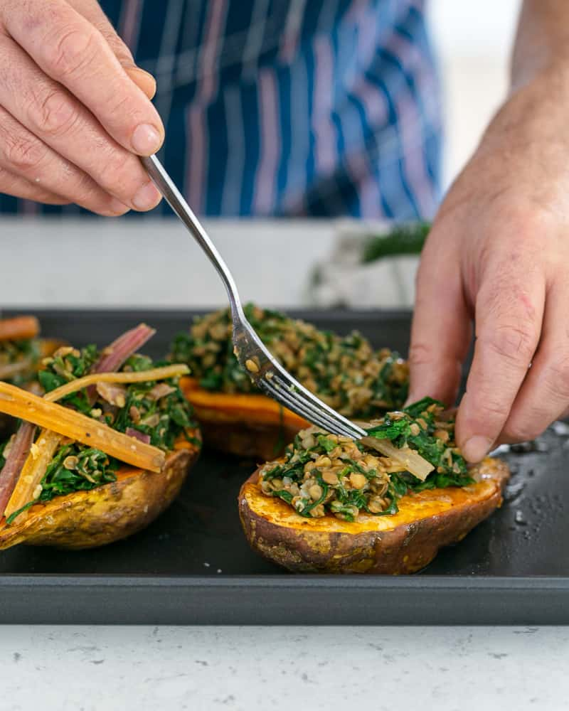 Assembling the sweet potato with lentils and swiss chard