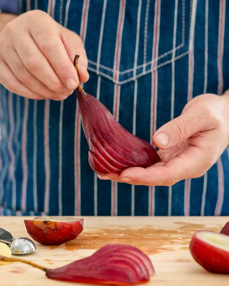 Pear cut in a fan shape to plate up spiced poached pears with mascarpone