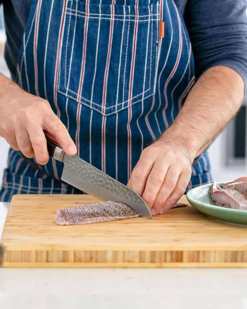 Snapper fillet cut into two for making seared red snapper