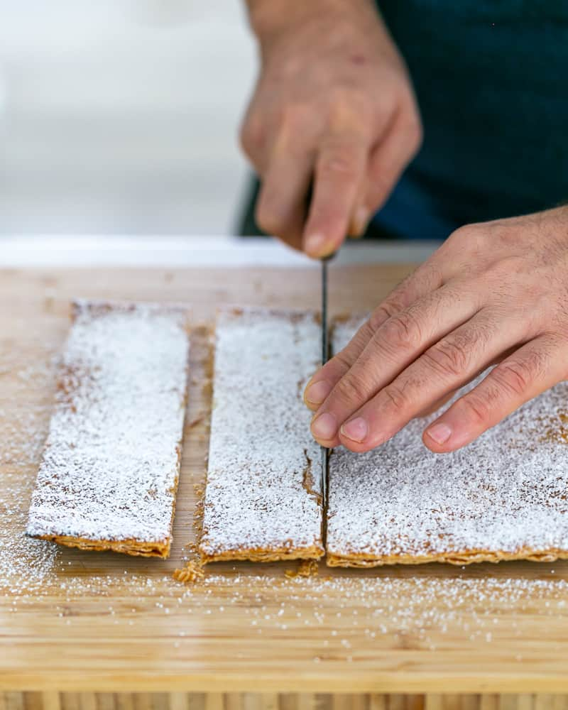 Cutting puff pastry in shards for Dulce de Leche Verrine with Banana and whipped Cream