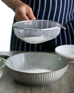 Sifting flour in a large bowl
