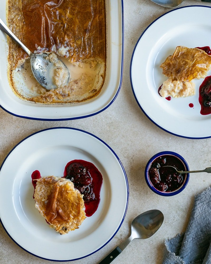French Baked Rice Pudding served in plates with berry compote