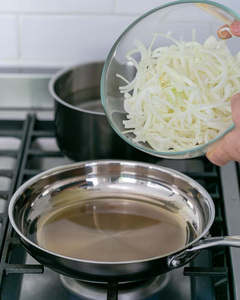 Sliced onions ready to be fried in hot oil