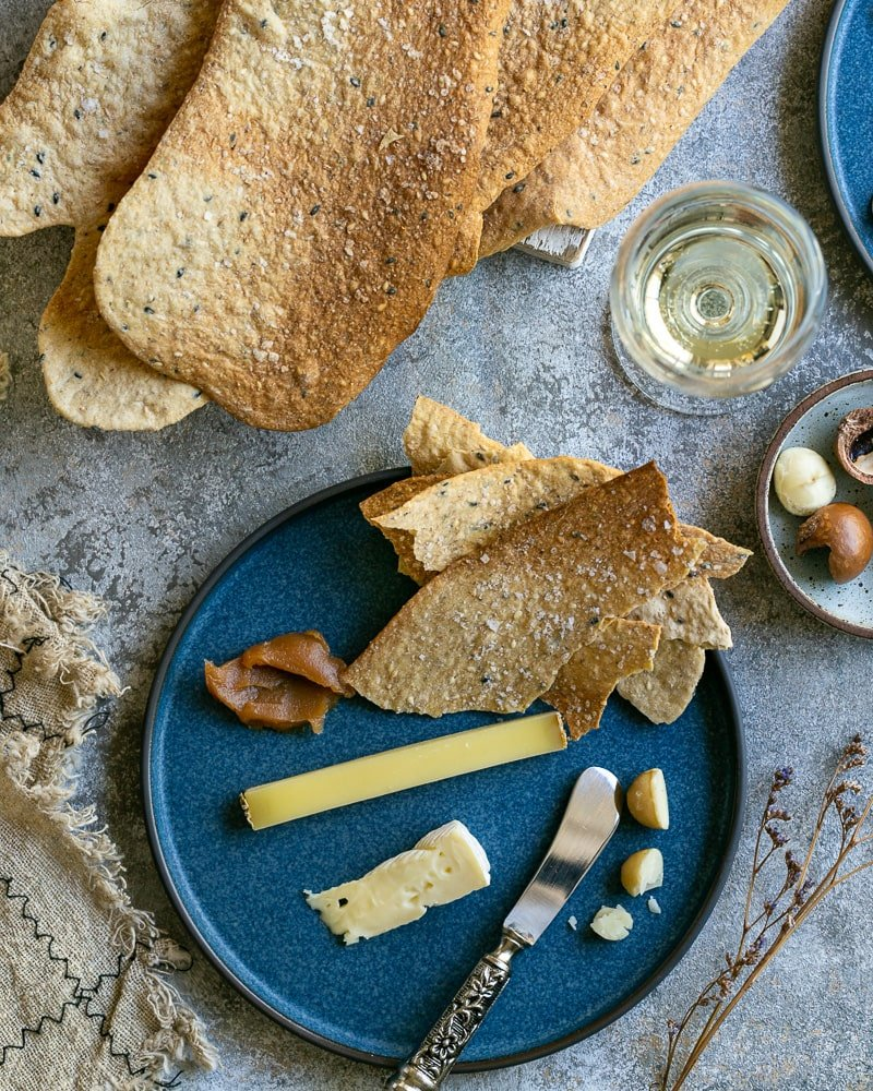Spiced lavosh crackers with cheese and wine
