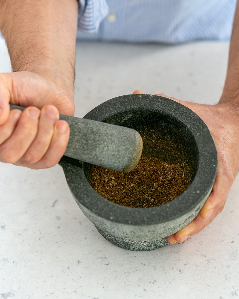 Toasted spices crusted in mortar and pestle