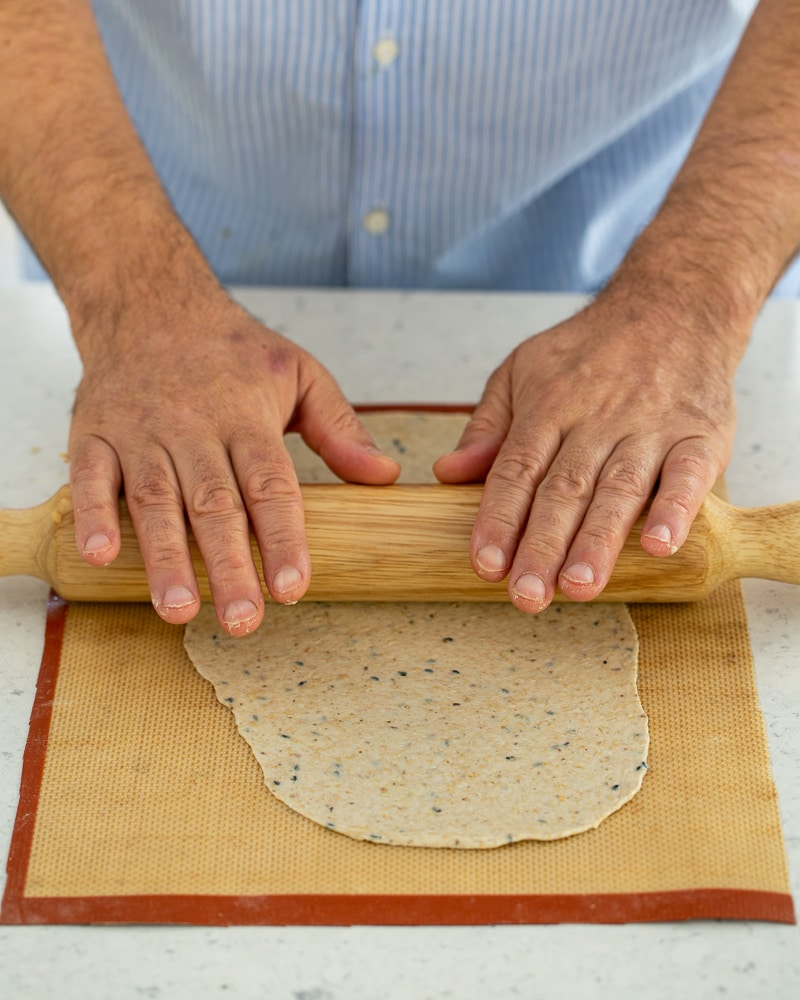 Rolling out the lavosh dough using a rolling pin