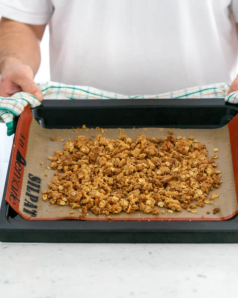 Baked oat crumble on a baking tray straight out of the oven