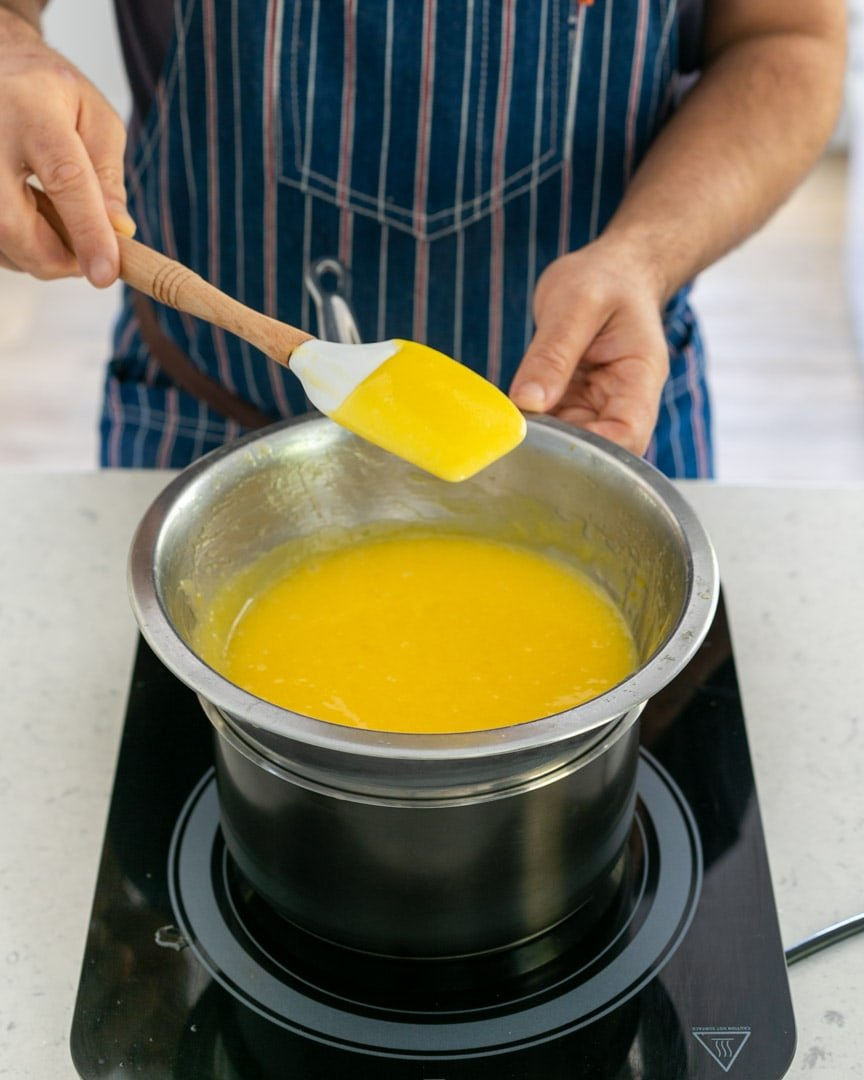 Lemon curd coating the back of a spoon when ready