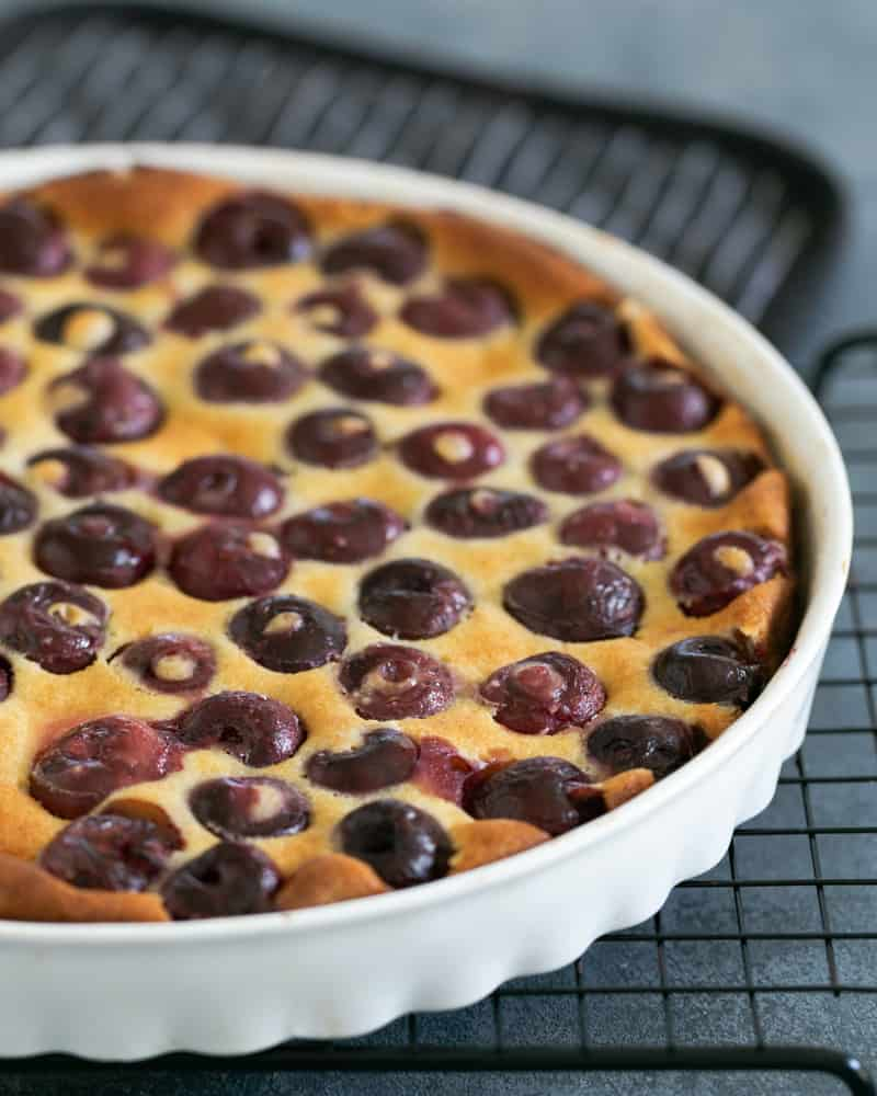 Freshly baked Cherry Clafouti on a cooling rack
