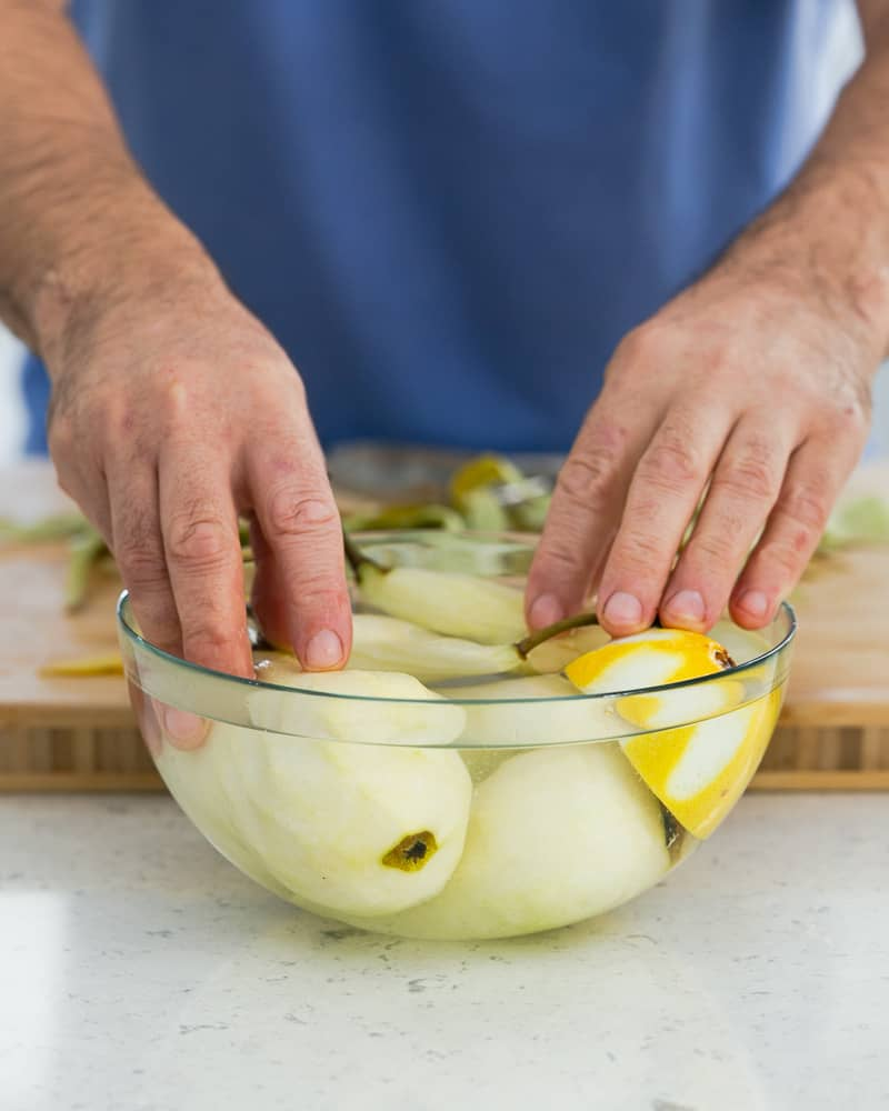 Peeled pears in lemon water to keep them from discolouring