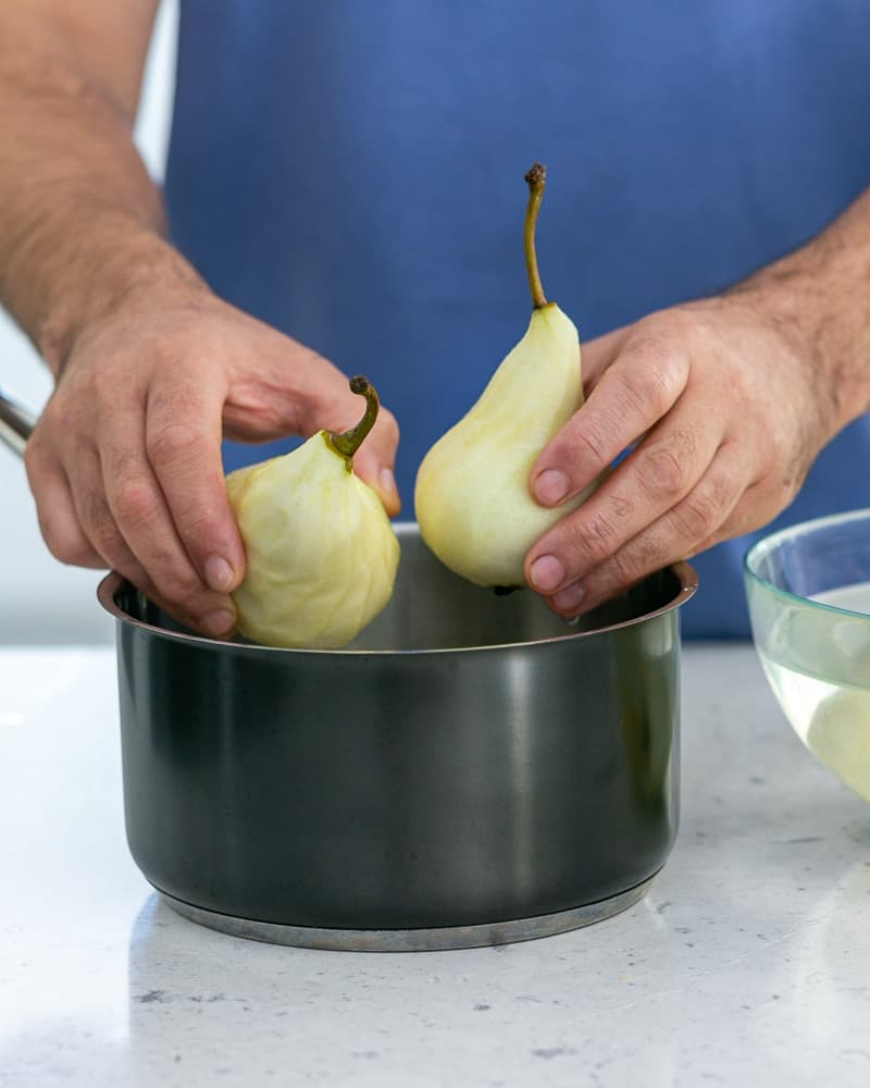 Add the peeled pears to a pot