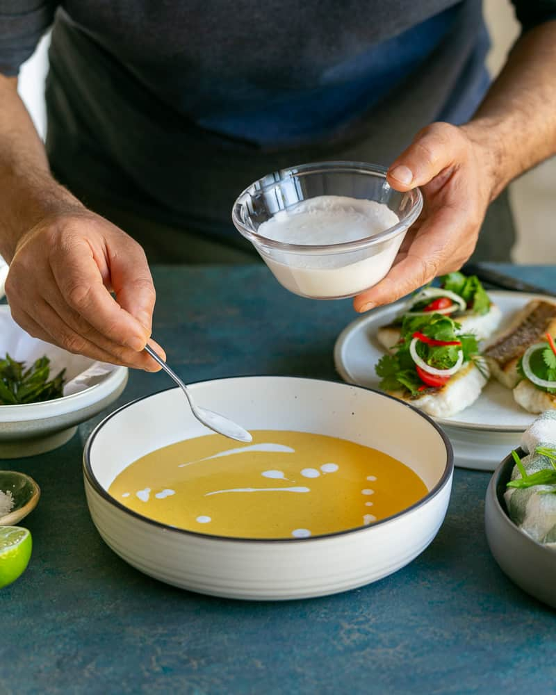 Coconut cream drizzled on the coconut curry sauce in the bowl