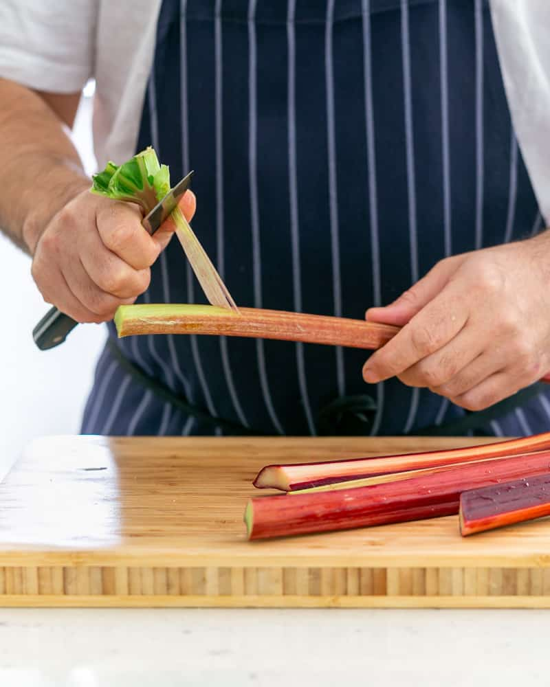 Peeling rhubarb with a small knife