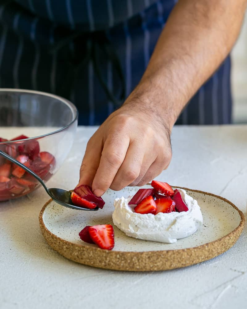 Placing the strawberry and rhubarb pieces around the plate