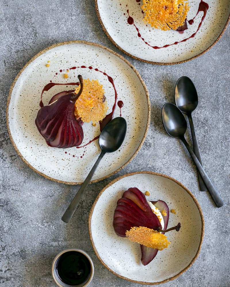 Spiced Poached pears with mascarpone in plates overhead picture