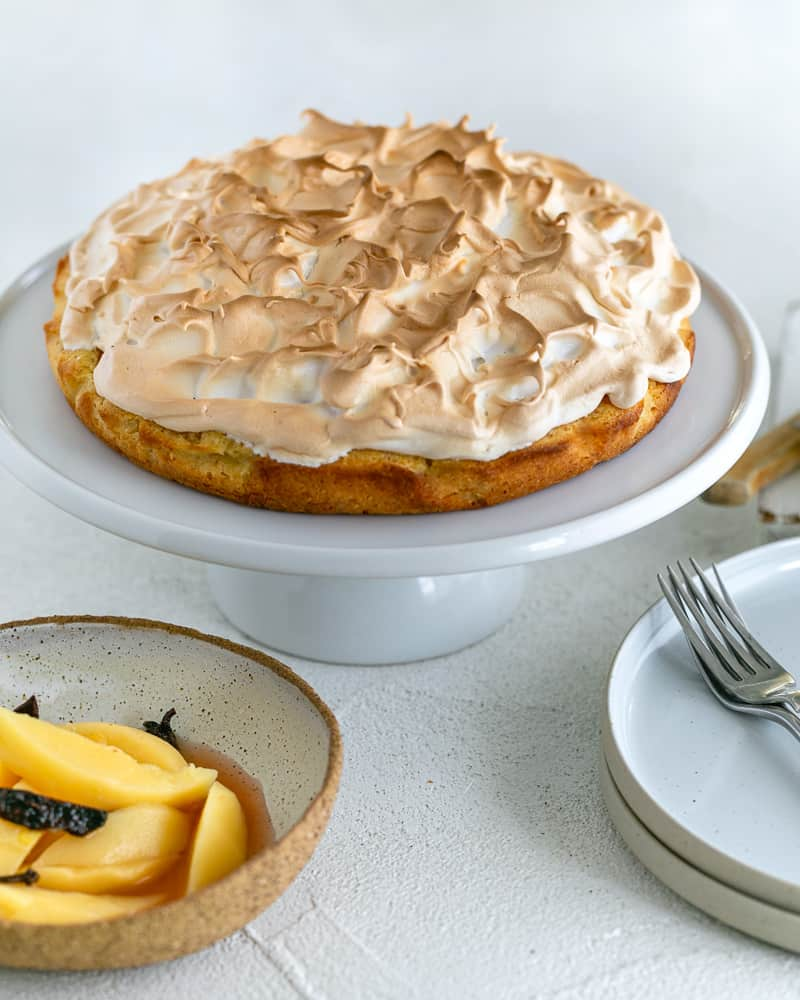 Quince Tart with Meringue on a cake stand