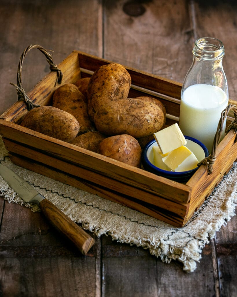 wooden grate with potatoes, milk and butter