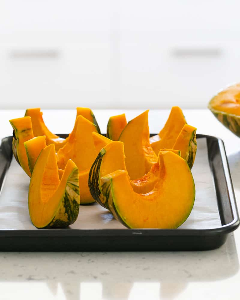 Pumpkin slices ready to be roasted for Roasted Pumpkin with Miso and Nori Nut Dukkah