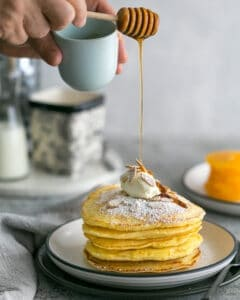 Souffle-Style Pancake stack with Fresh Ricotta and Almonds