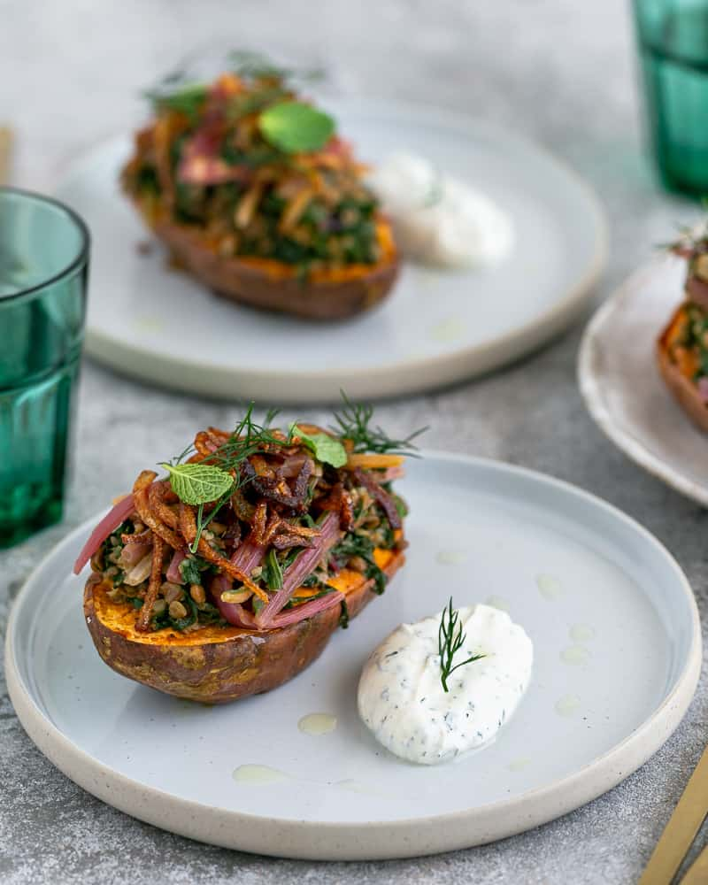 Baked sweet Potato with Lentils and Swiss Chard served in a plate like in a restaurant