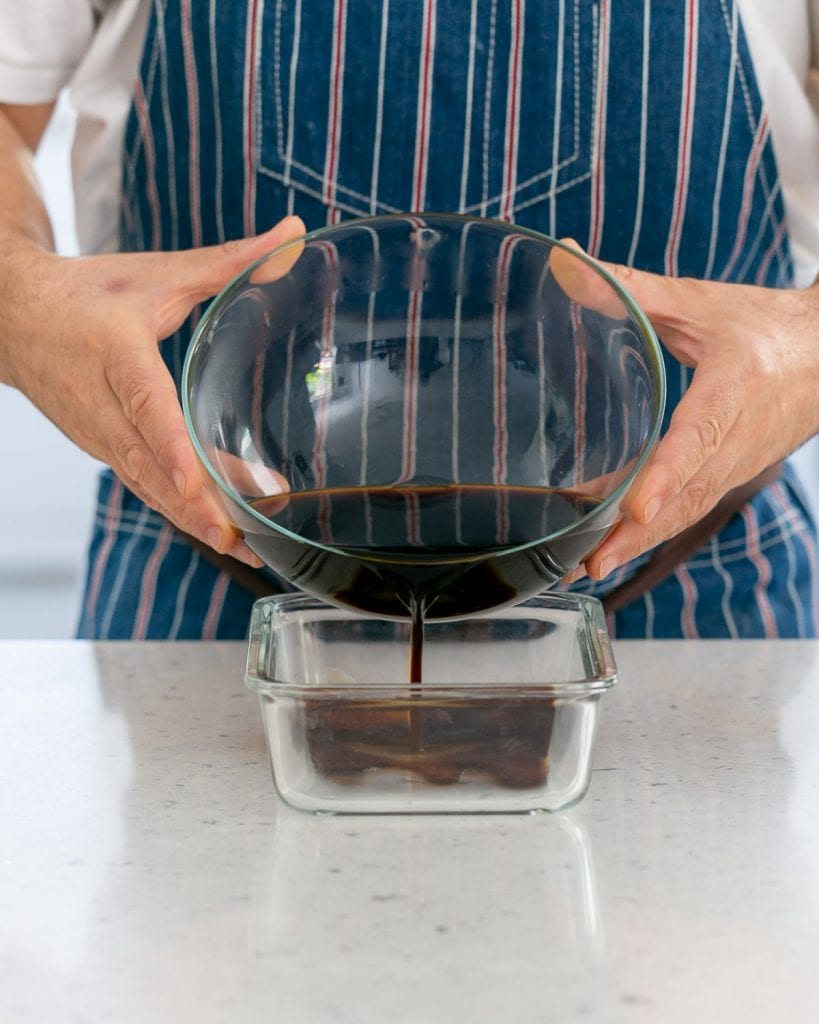 Pouring the coffee mix into baking dish to set in freezer