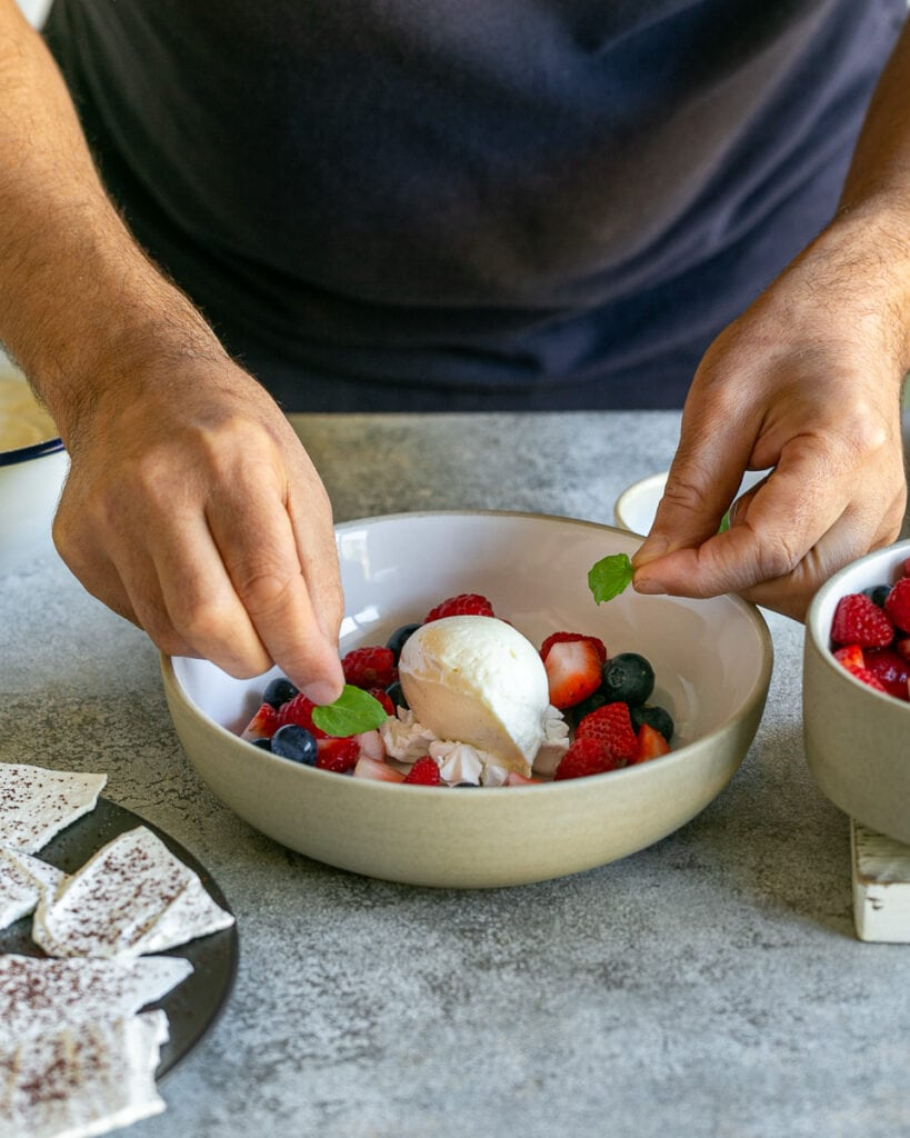 Decorating dessert with fresh mint leaves